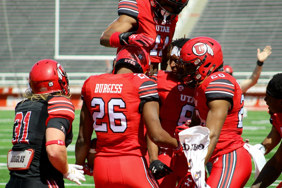 (Christopher Kamrani | The Salt Lake Tribune) Utah defensive back Terrell Burgess is mobbed by teammates after making an interception in Utah's Red-White game Saturday afternoon at Rice-Eccles Stadium.