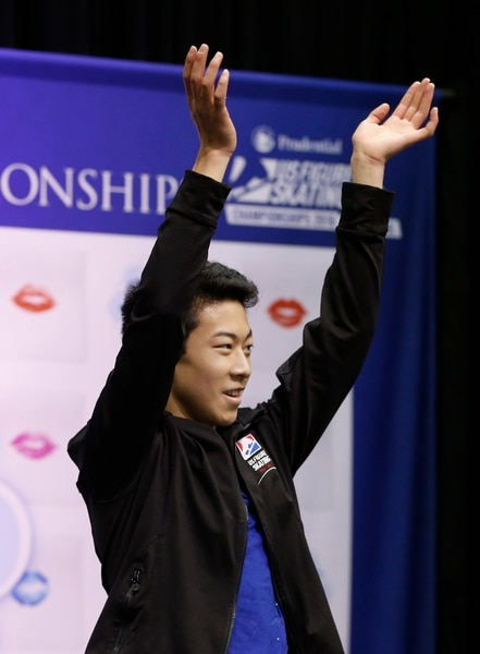 Nathan Chen celebrates after he completed the men's free skate program of the U.S. Figure Skating Championships, Sunday, Jan. 24, 2016, in St. Paul, Minn. Chen picked up the bronze medal in the men's program. (AP Photo/Jim Mone)