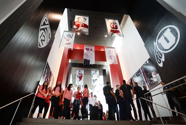 Steve Griffin   The Salt Lake Tribune The University of Utah's men's and women's basketball teams pause to take in their surroundings in their new practice facility, the Jon M. and Karen Huntsman Basketball Center, during grand opening ceremony on the University of Utah campus in Salt Lake City, Thursday, October 1, 2015.