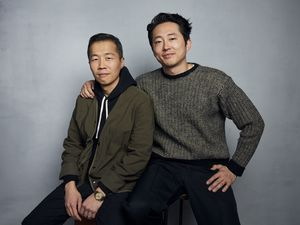 "(Taylor Jewell  |  Invision / Associated Press photo) Director Lee Isaac Chung, left, and actor Steven Yeun pose for a portrait to promote the film ""Minari"" at the Music Lodge during the Sundance Film Festival on Monday, Jan. 27, 2020, in Park City, Utah."