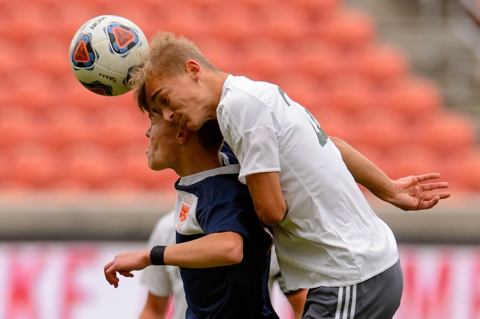 (Trent Nelson | The Salt Lake Tribune) Brighton's Cameron Neeley (12) and Olympus's Edvin Sabic (22) as Olympus faces Brighton High School in the 5A boys state championship game at Rio Tinto Stadium in Sandy, Thursday May 23, 2019.