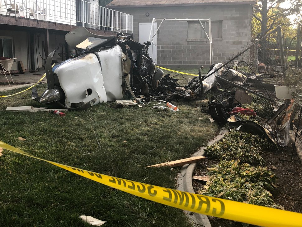(Sydney Glenn | FOX 13) The crash site where a small plane with six passengers hit a home in West Jordan on Saturday, July 25, 2020.