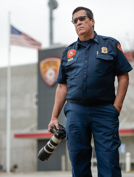 (Francisco Kjolseth | The Salt Lake Tribune) Fitzgerald Petersen, a captain with Unified Fire Authority often has a front row seat to documenting his colleagues on the fire line. For the past 17 years he's been the department's photographer. In that capacity, he listens to his radio on his off days and responds to incidents to document his coworkers.