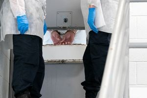 (Francisco Kjolseth | The Salt Lake Tribune) Prison staff work to safely move inmates from their cells into the common day room to be vaccinated against COVID-19 during a vaccination event with interested incoming inmates at the Utah State Prison in Draper on Tuesday, July 27, 2021.