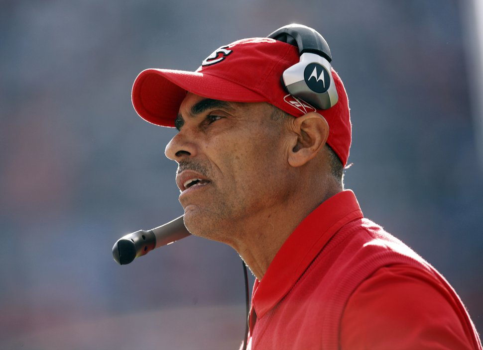 FILE - In this Dec. 7, 2008, file photo, Kansas City Chiefs coach Herm Edwards watches the team's NFL football game against the Denver Broncos in Denver. A person with direct knowledge of the plan has told The Associated Press that Edwards is in line to become Arizona State's next coach, pending approval of the university president. The official spoke to the AP on the condition of anonymity Wednesday night, Nov. 29, 2017, because the deal and official announcement are still being finalized. Edwards has not coached since 2008, when he was fired after a 2-14 season with the Chiefs. He also coached the New York Jets from 2001-05 and has spent the last nine years as an analyst for ESPN. (AP Photo/David Zalubowski, File)