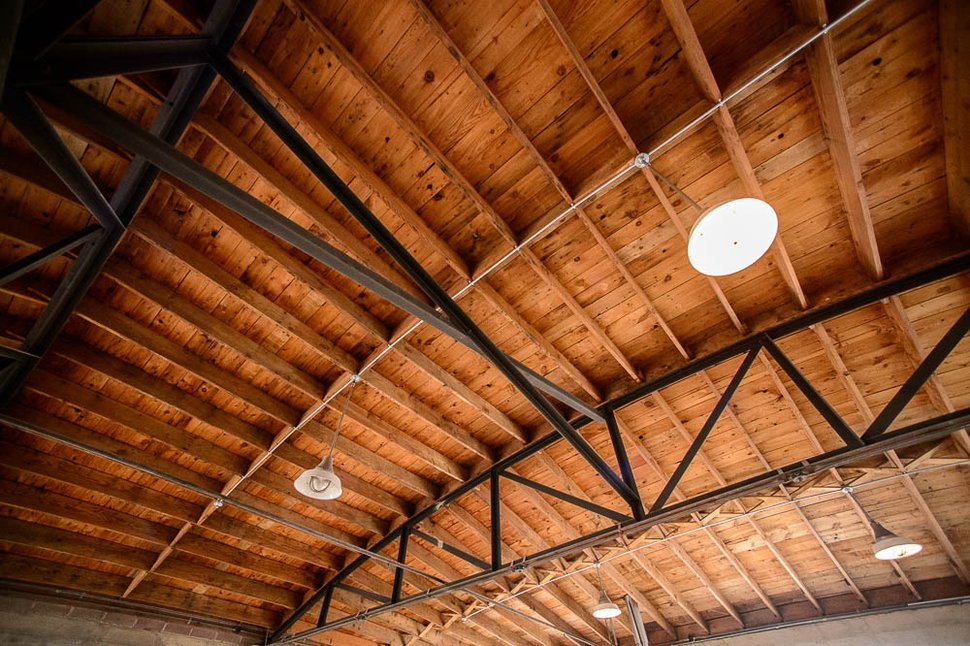 (Trent Nelson | The Salt Lake Tribune) Kevin Templin, the owner of T.F. Brewing, is excited to showcase the building's historic ceiling trusses. They were brought in by the original owners from the airplane hangar in the West Desert that housed the Enola Gay.