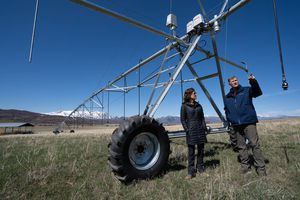 (Francisco Kjolseth  | The Salt Lake Tribune) Bill White, alongside his wife, Alane, talks about the central pivot watering system he purchased to help preserve the farmland surrounding the Trappist monastery in Huntsville on Tuesday, April 13, 2021. A deal has been reached to preserve most of the 1,800-acre agricultural operation that surrounds the monastery grounds in the rapidly subdividing Ogden Valley. White has agreed to donate much of the development rights to the land so that it remains as agricultural open space. White has invested heavily in the land's agricultural operations so that it would qualify for the $8.8 million in federal grants that are funding most of the deal.