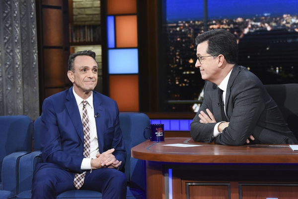 In this April 24, 2018 photo released by CBS, actor Hank Azaria, left appears with host Stephen Colbert on