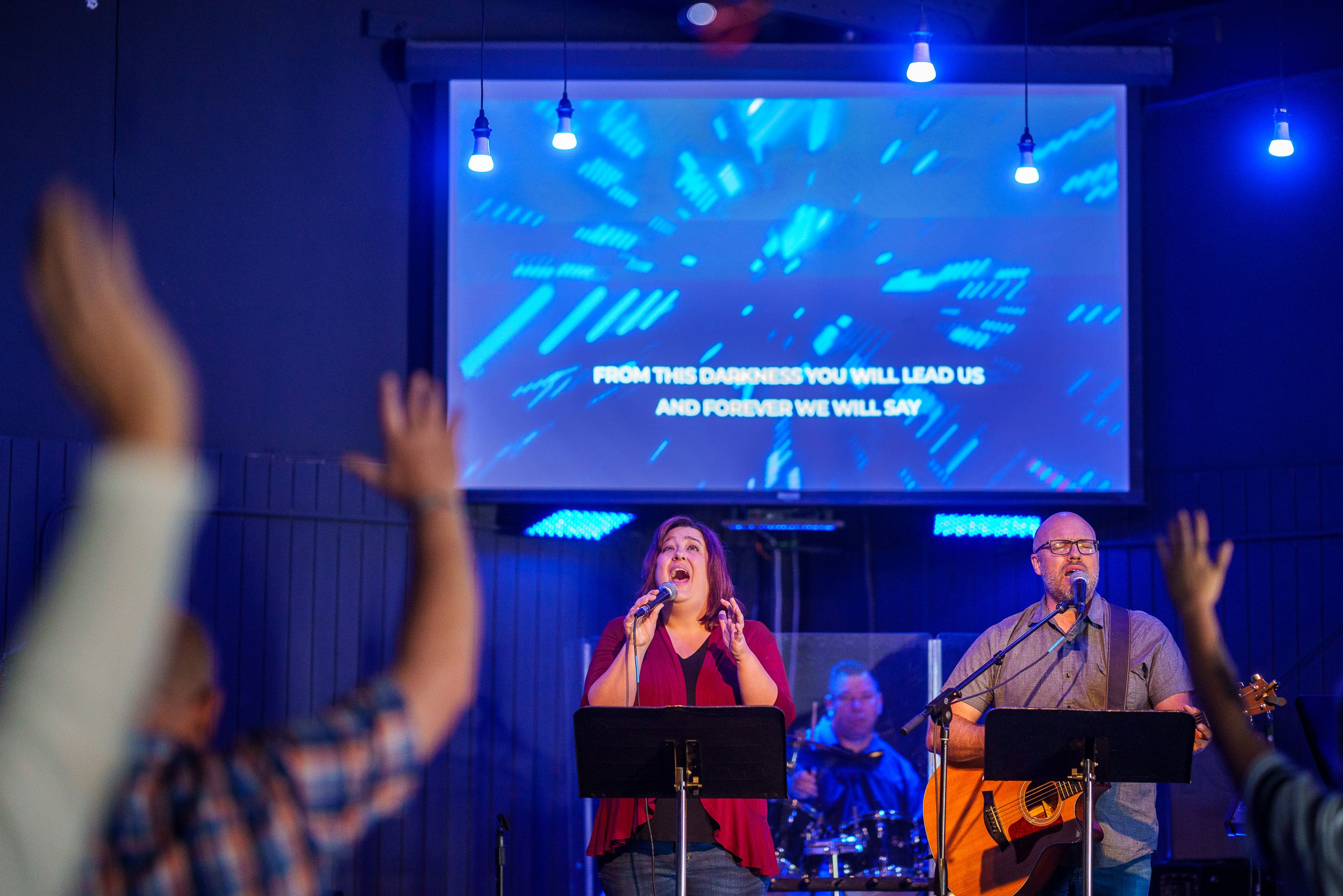 (Trent Nelson     The Salt Lake Tribune) Pastor Justin Banks, right, and his wife Heather sing during Sunday services at The Genesis Project in Provo on Sunday, May 16, 2021.