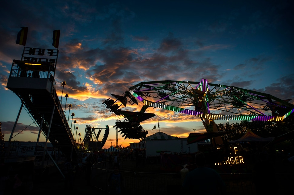 (Rick Egan | The Salt Lake Tribune) The Midway at the Utah State Fair lights up as the sunsets, Monday, Sept. 10, 2018.