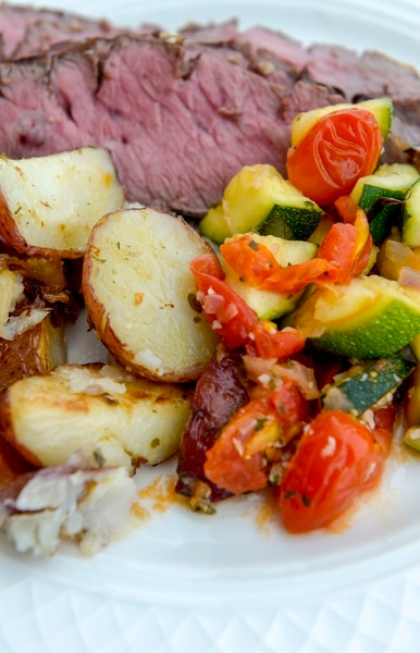 Leah Hogsten | The Salt Lake Tribune Sliced Flank Steak with red potatoes and sautéed zucchini with red grape tomatoes, $5 at O.C. Tanner's in-house company restaurant, Trebo, Oct. 19, 2018. O.C. Tanner is keeping their employees comforted through their stomachs. Trebo, an on-site restaurant that serves hearty breakfasts, lunches and dinners made from scratch and serves snacks and free drinks all day.
