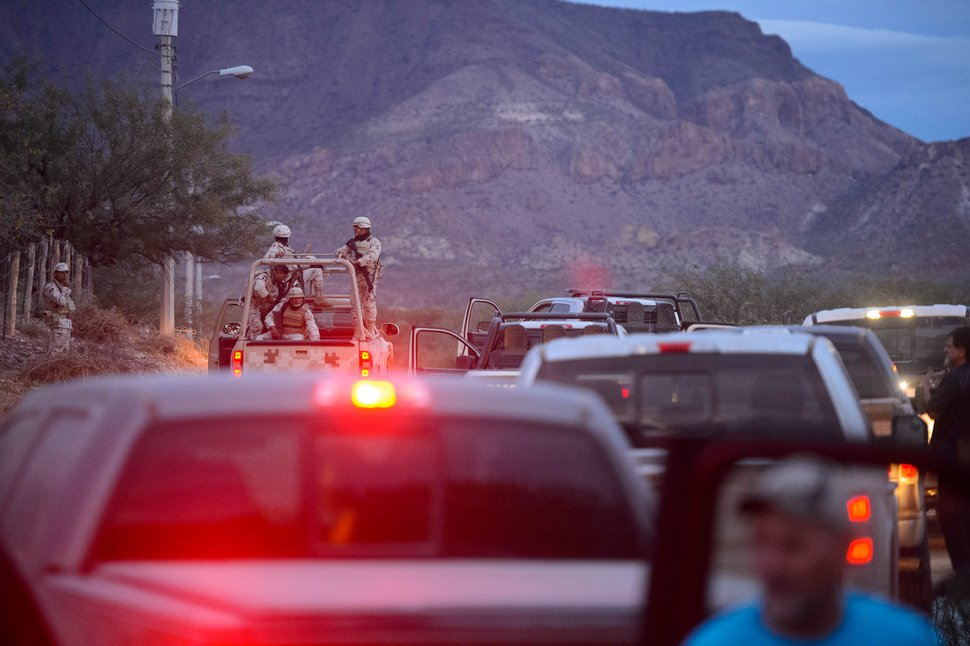 (Trent Nelson | Tribune file photo) A convoy of family members makes its way to La Mora, Sonora, with an escort of vehicles from the federal police and Mexican military on Wednesday, Nov. 6, 2019.