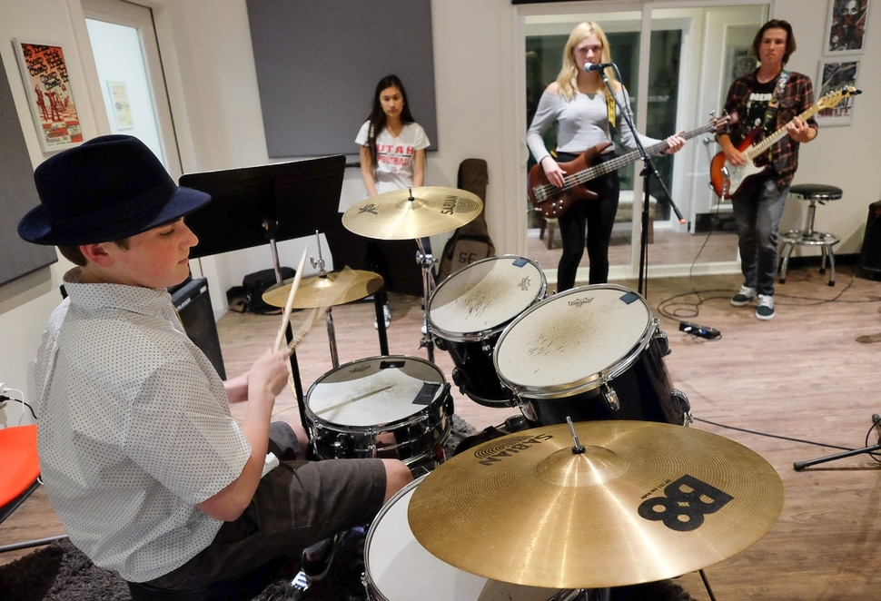 (Francisco Kjolseth | The Salt Lake Tribune) Miles Buchmann, 15, plays the drums as he joins other students in the after school program MusicGarage.org, in Sugarhouse on Monday, May 20, 2019.