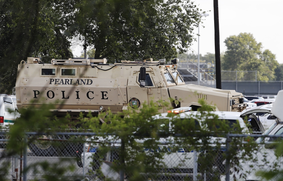 A Pearland Police armored vehicle stands ready in front of Santa Fe High School in Santa Fe, Texas, in response to a shooting on Friday morning, May 18, 2018. (Kevin M. Cox/The Galveston County Daily News via AP)