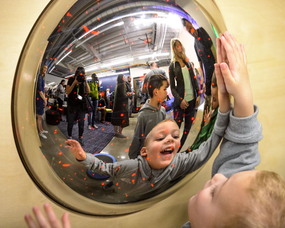 (Steve Griffin | The Salt Lake Tribune) Vaiden Price, age 3, smiles at his reflection in the new Sensory Room designed and built by Vivint Smart Home and the Utah Jazz inside the arena in Salt Lake City Wednesday March 14, 2018. The sensory room for individuals with intellectual and developmental disabilities opens to the public March 30.