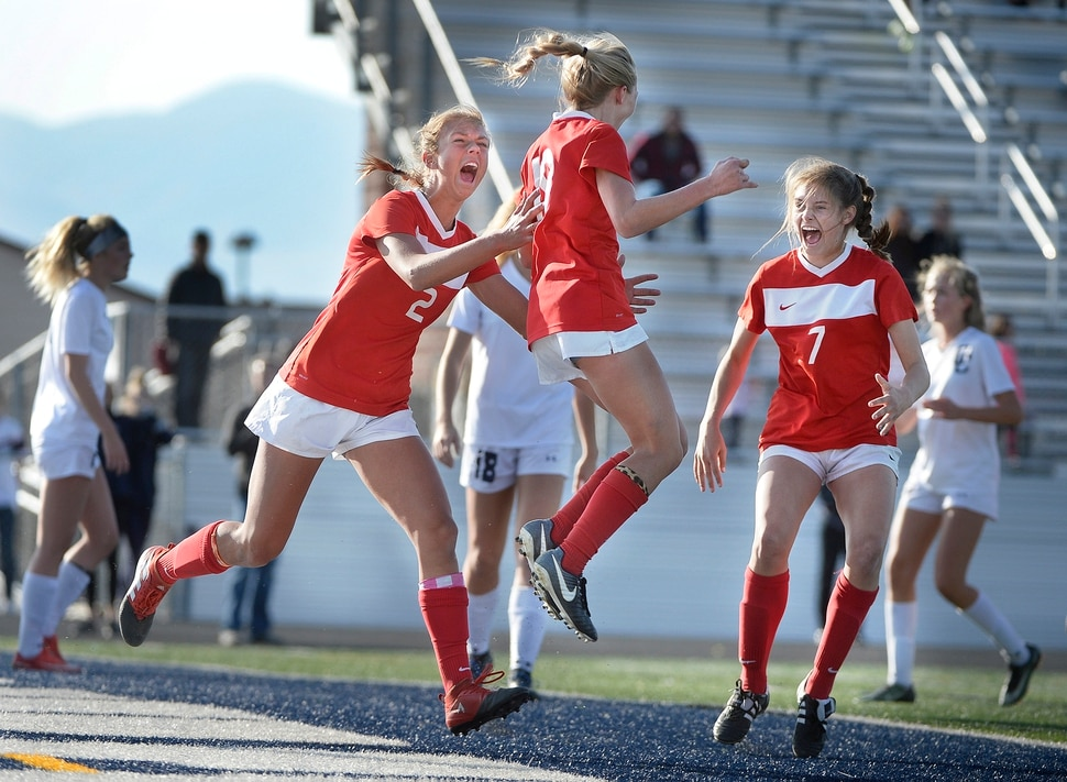 (Scott Sommerdorf | The Salt Lake Tribune) East forward Emily Jensen, center, celebrates with team mates Charlie Barta, left, and Erin Bridges, right after Jensen's header gave East a 1-0 lead against Corner Canyon during first half play. East beat Corner Canyon 4-1 in a Class 5A girls' soccer state quarterfinal, Thursday, October 12, 2017.