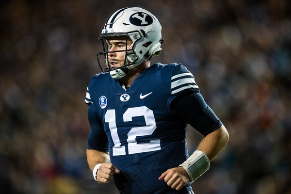 (Chris Detrick | The Salt Lake Tribune) Brigham Young Cougars quarterback Tanner Mangum (12) walks off of the field during the game LaVell Edwards Stadium Friday, October 6, 2017.