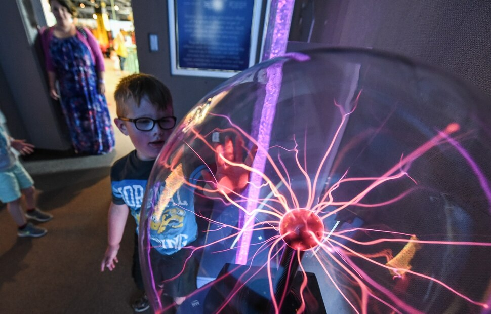 (Francisco Kjolseth | The Salt Lake Tribune) Milly Ortega keeps an eye on her son Tercel, 4, who is on the autism spectrum as he touches the various displays within the sensory room, at Discovery Gateway. The children's museum has been certified as a sensory-inclusive space for children on the autism spectrum - by offering quiet areas and sensory bags with headphones, fidget toys and other ways to help kids on the spectrum cope with unfamiliar, noisy surroundings.