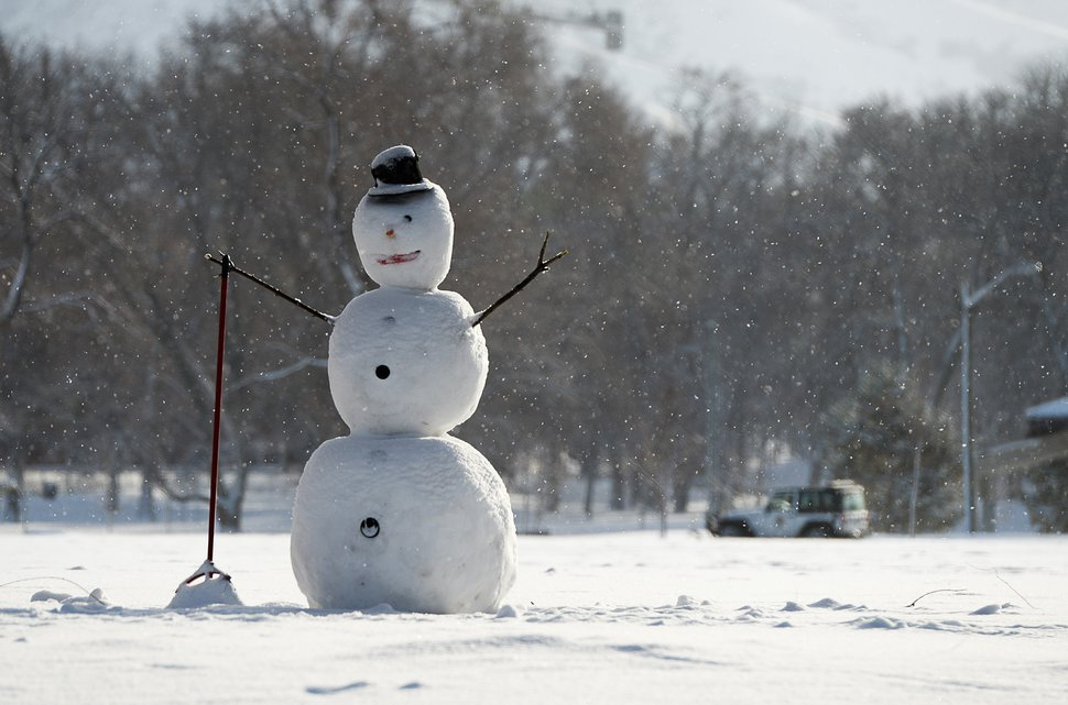 (Francisco Kjolseth   The Salt Lake Tribune) A frosty snowman greets passersby from the edge of Fairmont Park in Salt Lake City as crews clear sidewalks and roadways after another storm dropped a few inches in the valley on Monday, Feb. 11, 2019.
