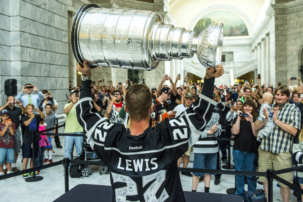Chris Detrick | The Salt Lake Tribune Los Angeles Kings' Trevor Lewis shows off the Stanley Cup to fans at the Utah State Capitol Wednesday August 27, 2014. Lewis is a Salt Lake City native who played for Brighton's club team as a freshman in 2002. Hockey tradition dictates that each member of the winning team gets custody of the Cup for one day.