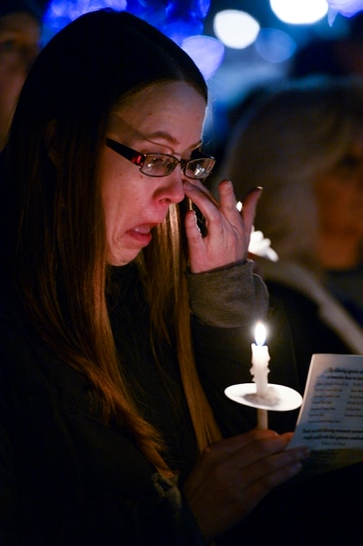 Leah Hogsten | The Salt Lake Tribune l-r Homeless services advocate Charlotte Kiefer wipes away tears for the homeless people she cared for who died in 2018. The Homeless PersonsÕ Memorial Day Candlelight Vigil, December 20, 2018 at Pioneer Park was in remembrance and honor of homeless persons who have died in Salt Lake City in 2018 and to call attention to homelessness.