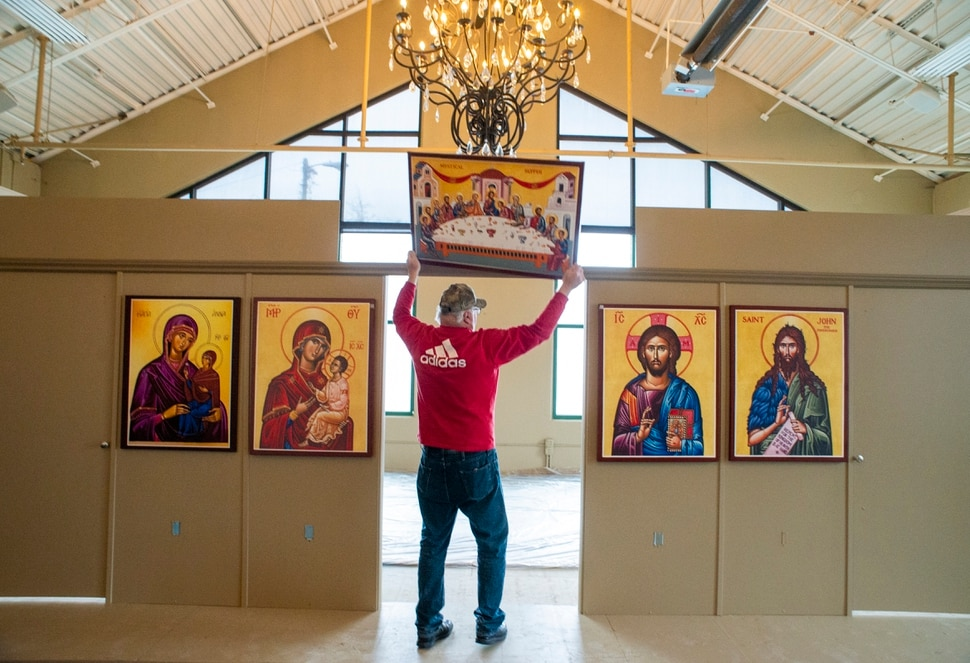 (Rick Egan | The Salt Lake Tribune) Chuck Karpakis hangs one of the icons, in the new St. Anna Orthodox Church in Sandy, Friday, Jan. 24, 2020.
