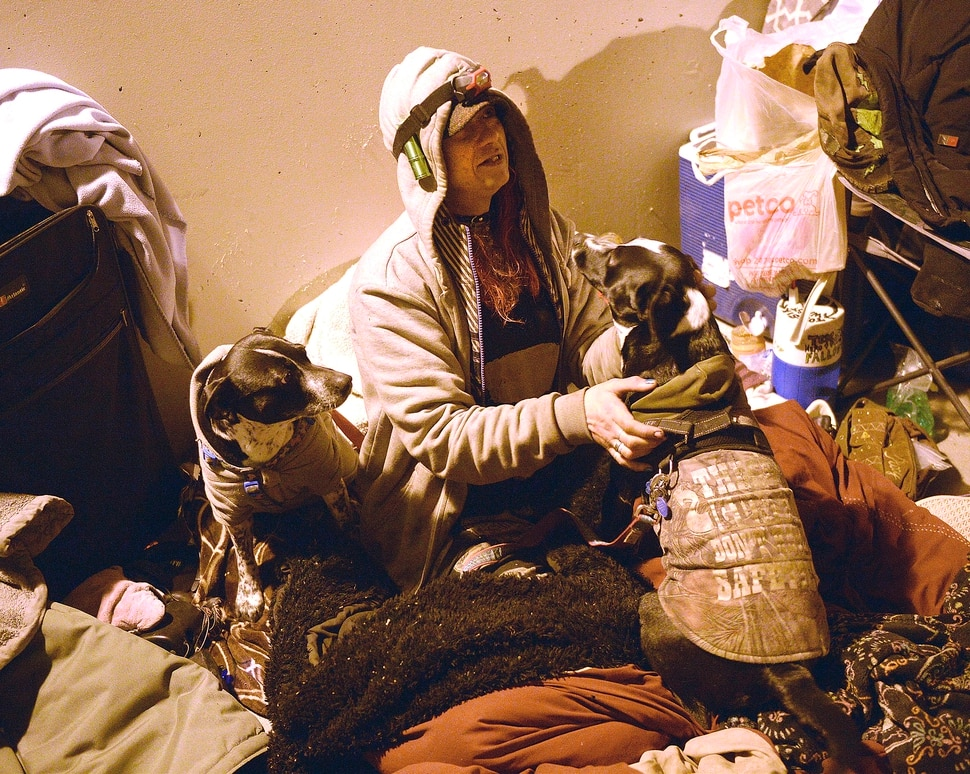 (Al Hartmann | The Salt Lake Tribune) A homeless woman called Thumper is interviewed while cuddled in her bedroll with her dogs Hope and Despair. Volunteers were counting homeless people in Salt Lake City for the annual Point In Time survey at 4:30 a.m. Thursday, Jan. 25, 2018. Thumper had spent the night with a couple friends, camped in the tunnel between Sugar House Park and Hidden Hollow.