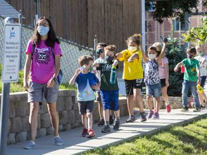 (Rick Egan  | Tribune file photo)  Children at the Jewish Community Center walk like mummies to help with social distancing as they take a nature walk on July 2, 2020.