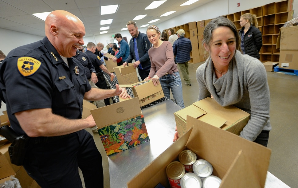 (Francisco Kjolseth   The Salt Lake Tribune) Police Chief Mike Brown and Director of the Salt Lake City Department of Public Utilities Laura Briefer help work the line assembling boxes of food as they join other officials and YouthCity Government students by volunteering at the Utah Food Bank to celebrate the 2020 Martin Luther King Jr. Day of Service on Monday, Jan. 20, 2020.