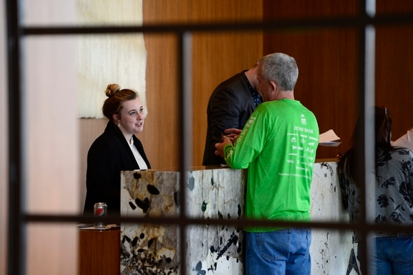 (Scott Sommerdorf | The Salt Lake Tribune) Camille Hollingsworth helps a guest at the reception desk at the new AC Hotel in downtown Salt Lake City, Friday, April 20, 2018. Hotels and other lodging properties had 11 percent more employees last month than in the previous March, helping to lead Utah to a 3.3 percent year-over-year job growth rate, the best in the nation.
