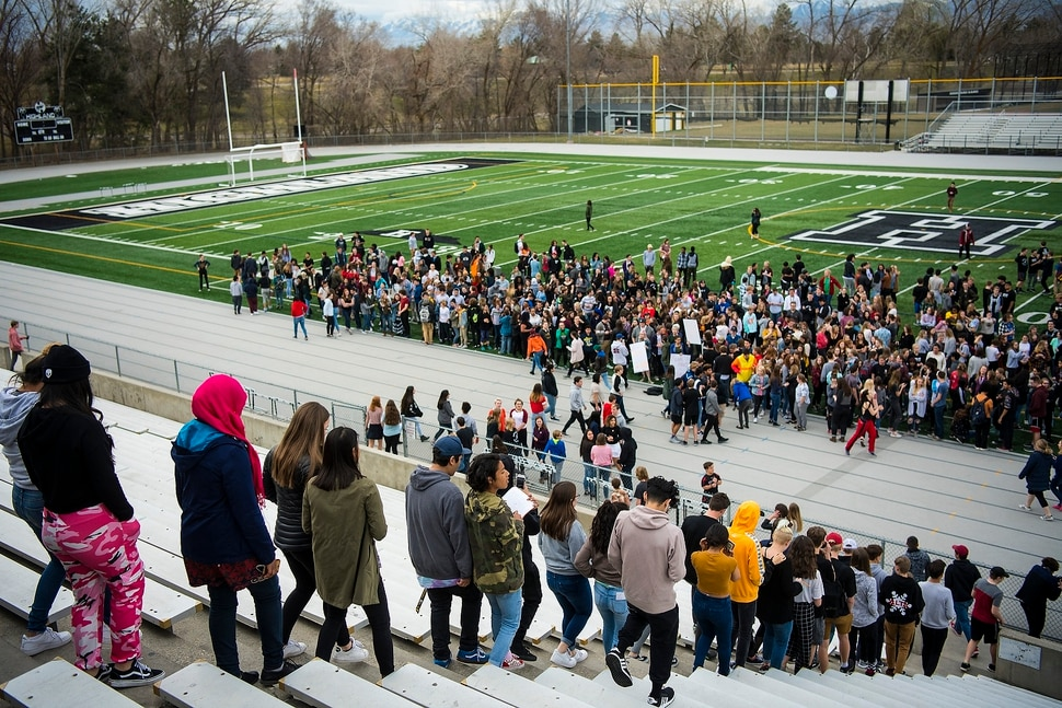 (Chris Detrick | The Salt Lake Tribune) Students at Highland High School in Salt Lake City gather on the football field to participate in a nationwide demonstration for better gun safety laws Thursday, March 15, 2018. Students at more than 30 schools along the Wasatch Front, nearly all of them high schools, particiapted in the 17-minute walkout — one minute for each of the Florida students killed.