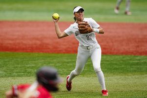 (Matt Slocum | AP) Mexico's Anissa Urtez throws to first after fielding a ground out by Canada's Victoria Hayward a softball game at the 2020 Summer Olympics, Tuesday, July 27, 2021, in Yokohama, Japan.