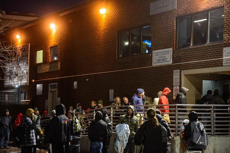 (Trent Nelson | The Salt Lake Tribune) Men line up for beds at The Road Home shelter in Salt Lake City on Wednesday Jan. 23, 2019.