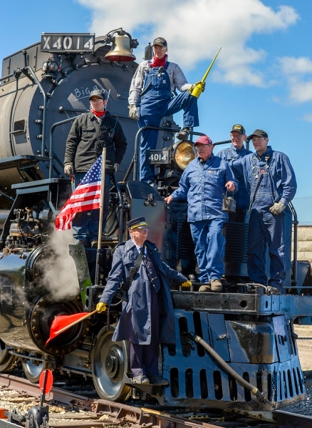 Leah Hogsten | The Salt Lake Tribune Big Boy No. 4014 crew including Jim Leonard, Jimmy Thompson, Ed Dickins, Bruce Kirk and Austin Barker pose for pictures after arriving in Ogden Thursday. In celebration for the 150th anniversary of the transcontinental railroadÕs completion, Union Pacific's iconic steam locomotives, Living Legend No. 844 and Big Boy No. 4014 met at Ogden Union Station, May 9, 2019.