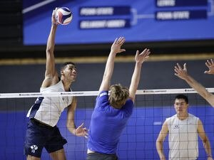 (BYU Photo) Gabi Garcia Fernandez, far left, goes for a kill during practice Wednesday. The Cougars will face Lewis in the NCAA Tournament semifinal on Thursday.