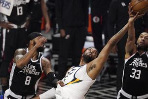 Utah Jazz center Derrick Favors, center, goes after a rebound along with Los Angeles Clippers forward Marcus Morris Sr., left, and forward Nicolas Batum during the second half of Game 3 of a second-round NBA basketball playoff series Saturday, June 12, 2021, in Los Angeles. (AP Photo/Mark J. Terrill)