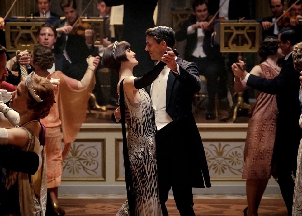 This image released by Focus features shows Michelle Dockery as Lady Mary Talbot, center left, and Matthew Goode as Henry Talbot in a scene from Downton Abbey. The highly-anticipated film continuation of the Masterpiece series that wowed audiences for six seasons, will be released Sept. 13, 2019, in the United Kingdom and on Sept. 20 in the United States. (Jaap Buitendijk/Focus Features via AP)