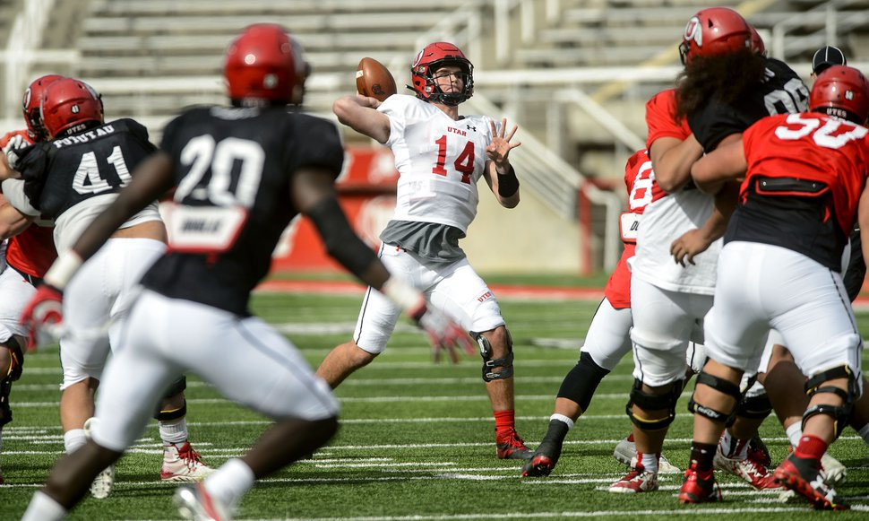 (Steve Griffin | The Salt Lake Tribune) Utah quarterback Jack Tuttle fires a pass downfield during the University of Utah football team's first scrimmage at Rice-Eccles Stadium in Salt Lake City Friday March 30, 2018.