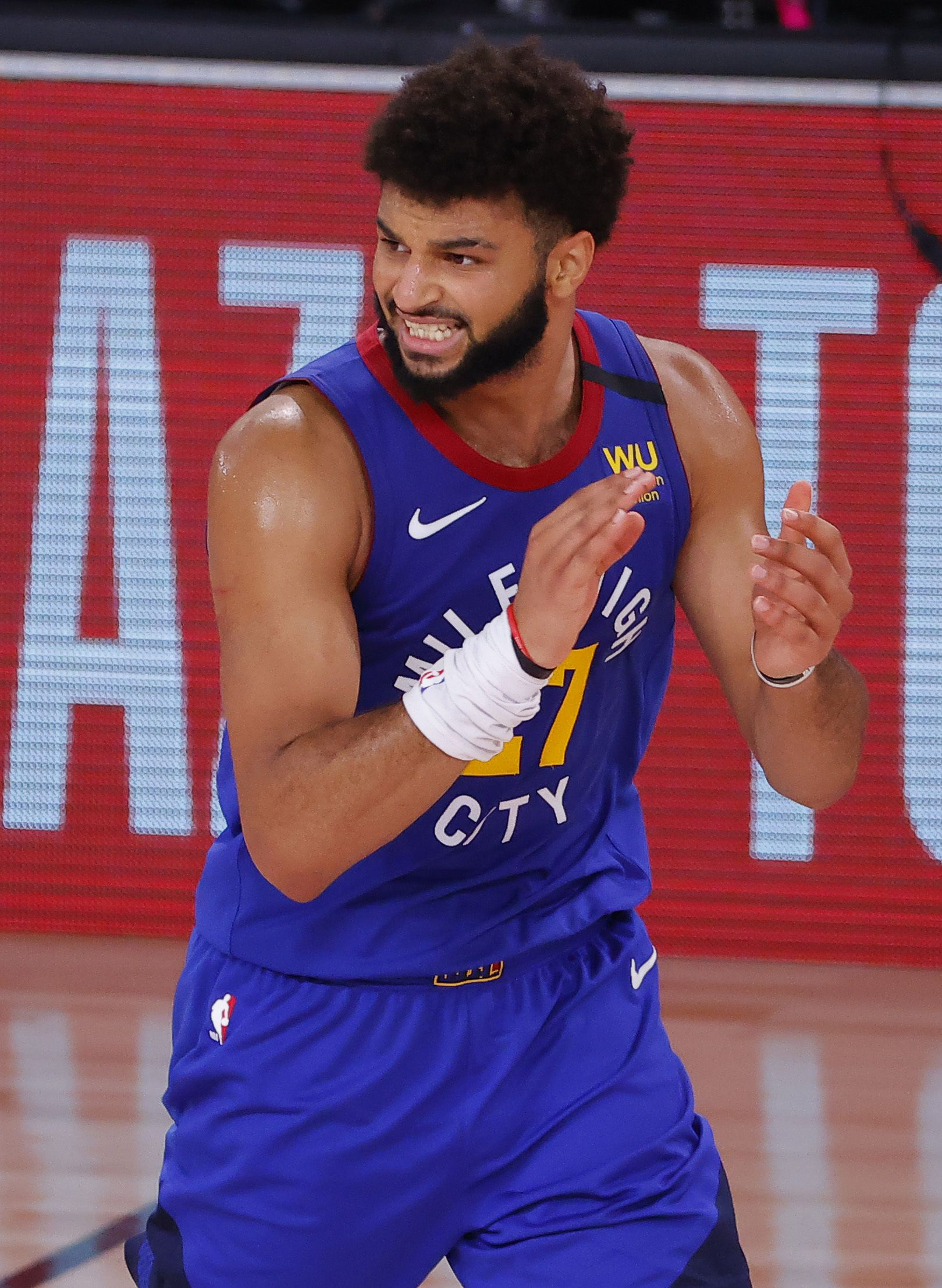 Denver Nuggets' Jamal Murray celebrates a 3-point basket against the Utah Jazz during the fourth quarter of Game 4 of an NBA basketball first-round playoff series, Sunday, Aug. 23, 2020, in Lake Buena Vista, Fla. (Kevin C. Cox/Pool Photo via AP)