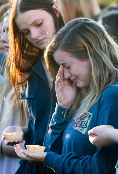 (Rick Egan | The Salt Lake Tribune) Southern Utah University student Taylor Heath (left) comforts Hayley Goen (right) during a candle light vigil for the victims of the Las Vegas shooting, on the SUU campus in Cedar City, Wednesday, October 4, 2017.