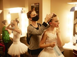 (Shawn Poynter   The New York Times) Dancers prepare to perform for a limited live crowd at the Tennessee Theatre in Knoxville, Tenn. on May 8, 2021. With safety restrictions easing, Americans from Maine to Montana are returning to concert halls, worship services and soapbox derbies in all 50 states.