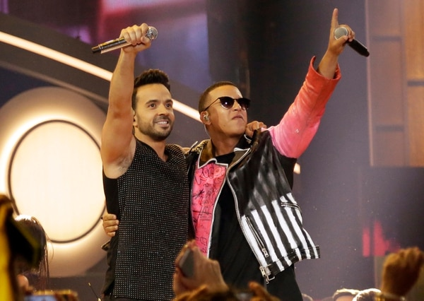 FILE - This April 27, 2017 file photo shows singers Luis Fonsi, left, and Daddy Yankee during the Latin Billboard Awards in Coral Gables, Fla. The success of their hit song