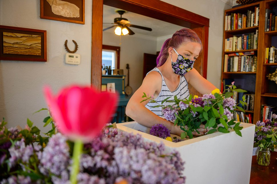 (Trent Nelson | The Salt Lake Tribune) Anna Zack, co-founder of Zack Family Farms, organizing Mother's Day deliveries at her home in Ogden on Saturday, May 9, 2020. Anna and Ben Zack started Zack Family Farms last fall with hopes of selling flowers to florists for weddings. But during COVID-19, they had to adapt and are now making home deliveries with their flowers.