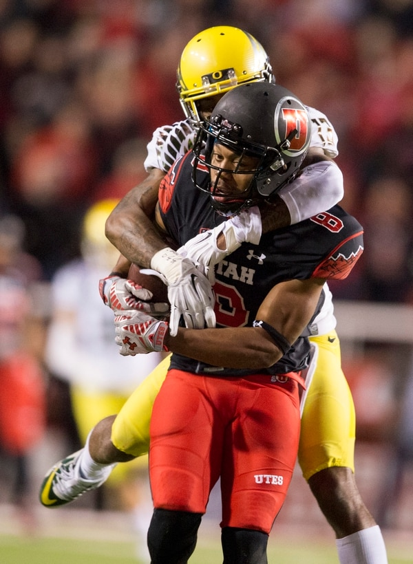 Rick Egan | The Salt Lake Tribune Oregon Ducks defensive back Troy Hill (13) tries to stop Utah wide receiver Kaelin Clay (8) after he hauls in a long pass for the Utes, in Pac-12 football action, Utah vs. Oregon game, at Rice-Eccles Stadium, Saturday, November 8, 2014
