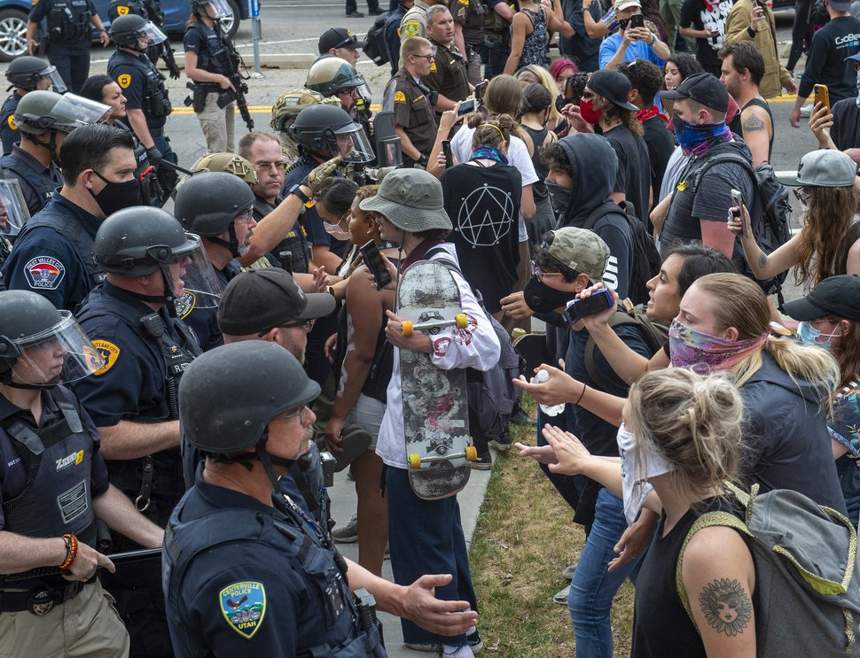 (Rick Egan | The Salt Lake Tribune) Police force protesters down 300 East, Saturday, May 30, 2020.