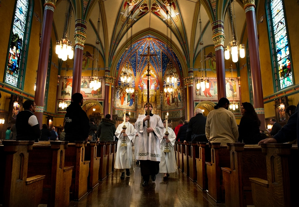 (Scott Sommerdorf | The Salt Lake Tribune) The procession leaves at the end of the early morning Christmas Eve mass on the fourth Sunday of Advent at the Cathedral of the Madeleine, Sunday, December 24, 2017.