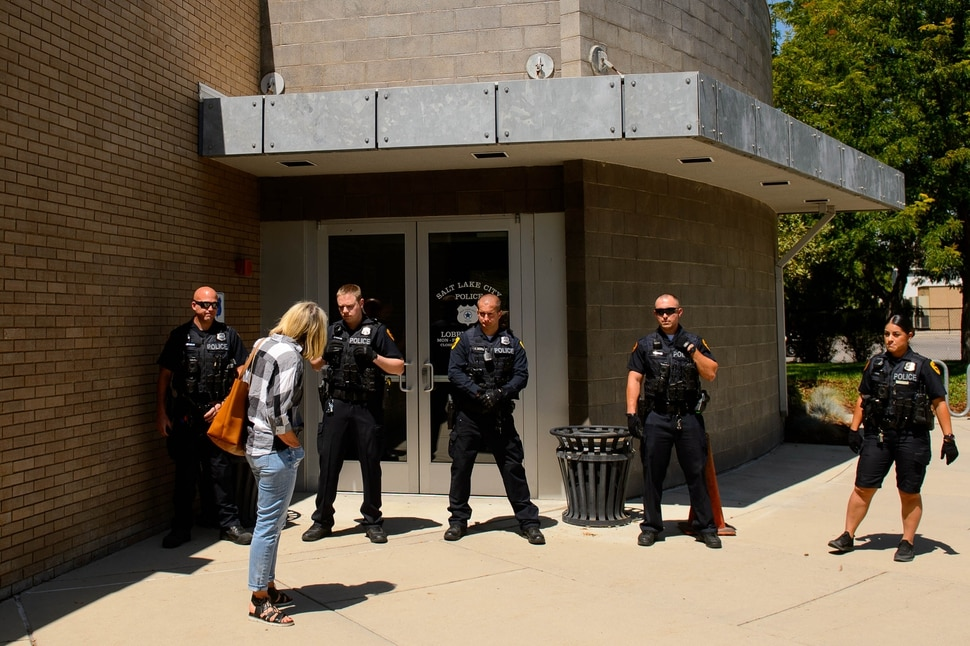 (Trent Nelson | The Salt Lake Tribune) Police stand guard after a meeting of an inland port satellite working group was quickly canceled. The meeting was held at a police precinct in Salt Lake City on Wednesday Aug. 14, 2019.
