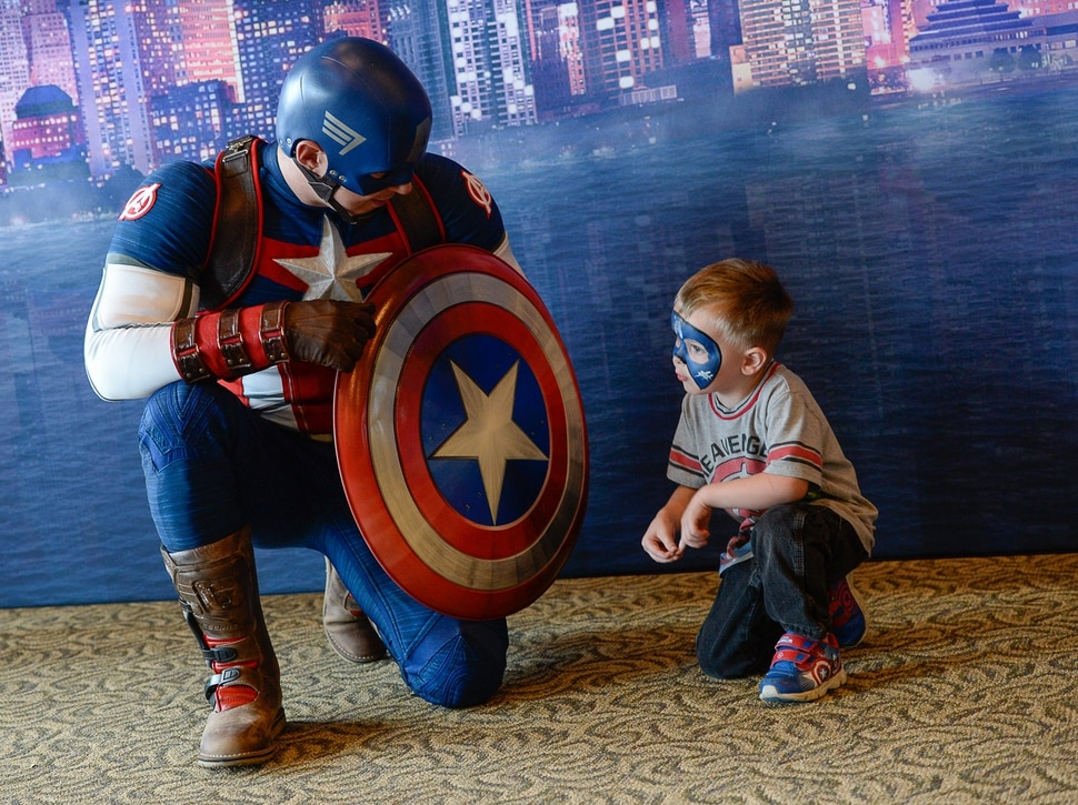 (Francisco Kjolseth | The Salt Lake Tribune) Corbin Gleave, 6, tells Captain America all about it as Utah-based military families gather for the Salt Lake opening night of the all-new Marvel Universe LIVE! Age of Heroes, witnessing their favorite Marvel super heroes, including The Avengers, Spider-Man and the Guardians of the Galaxy in an action-packed adventure at the Maverik Center on Thursday, Sept. 28, 2017. MarvelÕs greatest military Super Hero Captain America was partnered with Got Your 6, a military veteran non-profit group dedicated to empowering veterans to lead and build stronger communities across America.