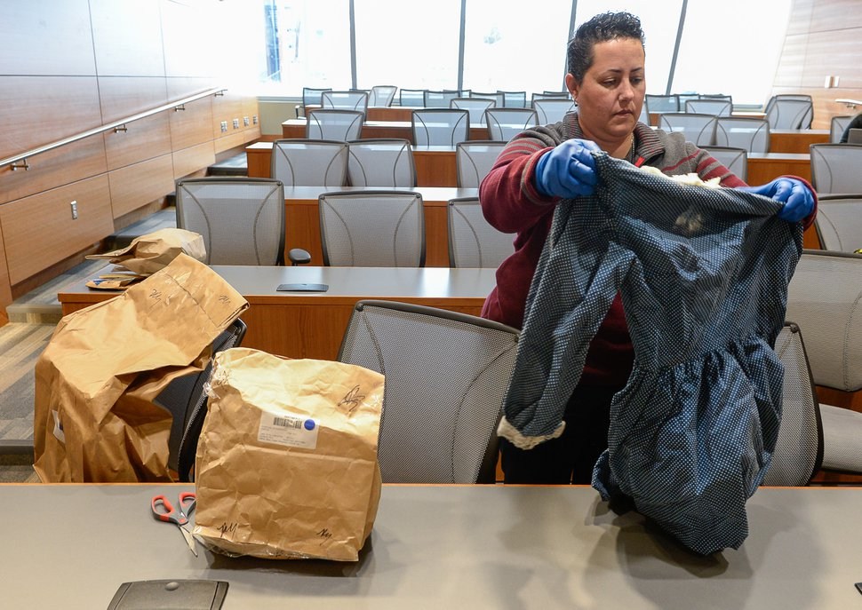 Francisco Kjolseth | The Salt Lake Tribune Salt Lake police detective Hilary Gordon, seen here in a 2015 file photo, reveals a handmade dress as the department seeks the publicÕs assistance in identifying a white female, whose decomposing body was found on September 3, 1986, floating in a canal east of a sewage treatment plant at 1850 North Redwood Road. The State Medical ExaminerÕs Office determined the death to be suspicious.