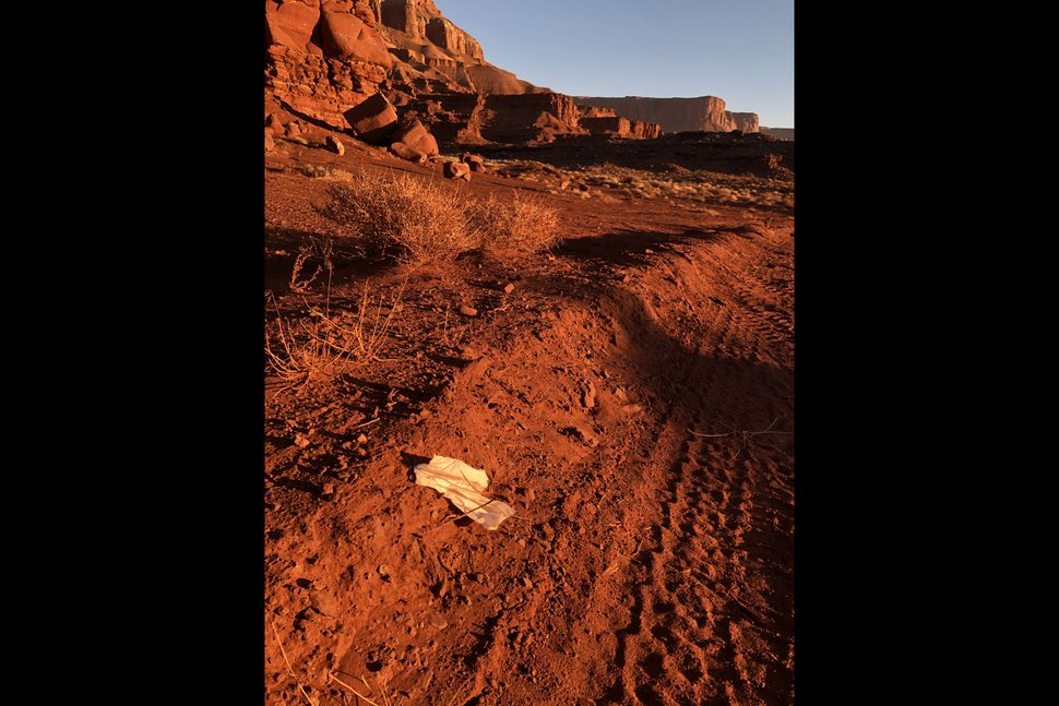 (Photos courtesy of the Bureau of Land Management) A piece of toilet paper or litter sticks out of the ground near the Utah